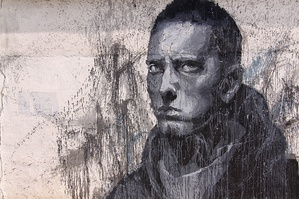 Large graffiti picture of a serious-looking Eminem