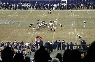 2002 Army–Navy Game at Giants Stadium. Navy is in dark and Army is in white.