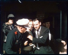 Lee Harvey Oswald being brought out of the Texas Theatre immediately after his arrest