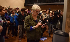 Kim Metcalfe tallies votes at the Juneau Democratic Caucus on Saturday, March 26, 2016 in Centennial Hall's Sheffield Ballroom as voters hold up their cellphones to capture the results. (James Brooks photo)