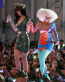 Katy Perry (left) and Minaj (right) perform for service members during the 2010 VH1 Divas Salute the Troops concert.