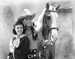 Lynne Roberts and Rogers in Billy the Kid Returns, 1938