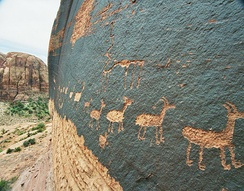 A petroglyph of a caravan of bighorn sheep near Moab, Utah, United States, a common theme in glyphs from the desert southwest