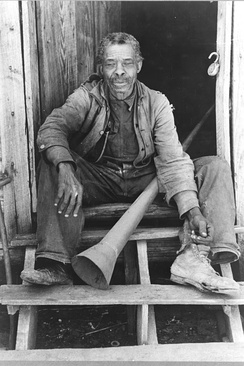 Former slave with horn historically used to call slaves, Texas, 1939. Photo by Russell Lee.