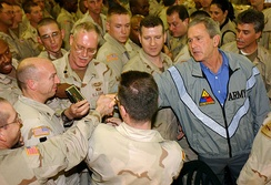 President Bush paying a surprise visit to Baghdad International Airport, November 27, 2003