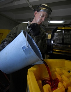Hydraulic fluid being poured into a storage container