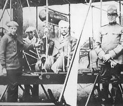 Vermont Governor Charles W Gates examines a Vermont National Guard airplane at Fort Ethan Allen in 1915. At his left is VT Adjutant General BG Lee S Tillotion