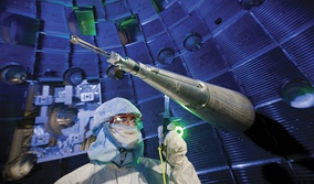 Engineers, scientists and technicians at work on target positioner inside National Ignition Facility (NIF) target chamber