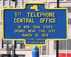 Historical marker commemorating the first telephone central office in New York State (1878)
