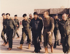 Adnan Khairallah, Iraqi Defense Minister, meeting with Iraqi soldiers during the war