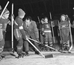 Youths being taught how to properly deliver a check in ice hockey