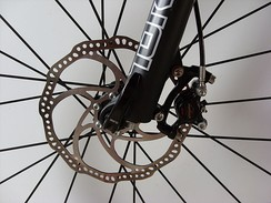 A front disc brake, mounted to the fork and hub