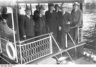 In July 1931 British politicians visited Prussia. In the photograph,  from left to right: German Foreign Minister Julius Curtius, British Foreign Secretary Arthur Henderson, German Chancellor Heinrich Brüning, British Prime Minister James Ramsay MacDonald and (later dismissed)  Ministerpräsident of Prussia Otto Braun. The photo was taken during a ship excursion on the Wannsee, Berlin.