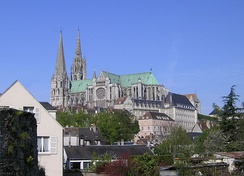 Chartres roofline and profile rising over the modern town