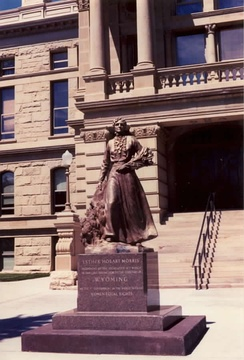 Wyoming State Capitol Building in Cheyenne. State officials in 1960 presented a copy of this 1953 bronze statue of Esther Hobart Morris for display at the U.S. Capitol's National Statuary Hall Collection in Washington, D.C.