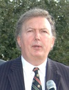 Greg knight speaks at meeting (cropped).jpg