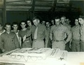 Austin R. Brunelli cutting the cake with the members of the 24th Marine Regiment during the celebration of the Marine Corps Birthday in Maui, 1944.