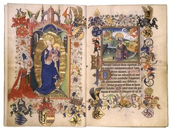 Opening from the Hours of Catherine of Cleves, c. 1440, with Catherine kneeling before the Virgin and Child, surrounded by her family heraldry. Opposite is the start of Matins in the Little Office, illustrated by the Annunciation to Joachim, as the start of a long cycle of the Life of the Virgin.[1]