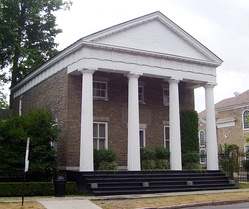 The Clark Estates building, originally the Otsego County Bank, was built in 1831 in the Greek Revival style