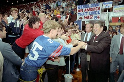 President Ronald Reagan shaking hands with unidentified members of the crowd while at Bowling Green University in Ohio on September 26, 1984.