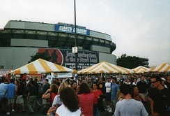 The scene outside the Giants Stadium parking lot for banner-marked, record-setting, 10-night stand of The Rising Tour during July 2003.