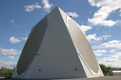 The 11-story tall SSPARS in its protective dome at Clear Air Force Station is operated by the 213th Space Warning Squadron.
