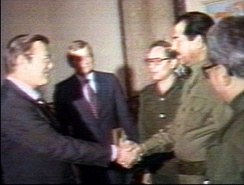 Saddam Hussein meets Donald Rumsfeld during the Iran–Iraq War. Hussein ruled Iraq from 1979 until 2003.