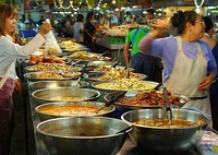 A market stall at Thanin market in Chiang Mai, Thailand selling ready cooked food