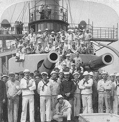 Crewmen pose under the gun turrets of Iowa in 1898.