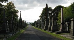The vista westwards along the main promenade of Undercliffe Cemetery with monuments to either side and the Joseph Smith obelisk in the far distance