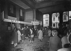 The Higher Market, Exeter, in 1943; at this time the larger firms such as Mac Fisheries had joined the smaller shopkeepers' stalls in the market, which, before the war, along with neighbouring Goldsmith Street, was earmarked for demolition; a new Civic Centre was to be built on the site