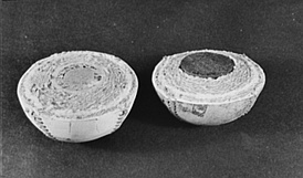 Halves of two baseballs; traditional cork-centered (left) and rubber-centered