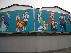 China's Kyrgyz people (柯尔克孜族) portrayed on a poster near the Niujie Mosque in Beijing. (Fourth from the left, between the Dongxiang and the Kam).