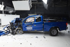 The Toyota Tacoma is one of most vehicles that passed the institute's challenging small overlap test, but the Dodge Grand Caravan performed poorly.