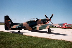 A Cavalier Mustang, formerly of the Bolivian Air Force, parked on a Canadian airfield.