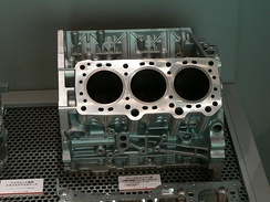 Block of a modern V6 diesel engine. The large holes are the cylinders, the small round orifices are mounting holes and the small oval orifices are coolant or oil ducts.