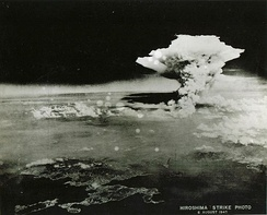 "For decades this ""Hiroshima strike"" photo was misidentified as the mushroom cloud of the bomb that formed at c. 08:16.[158][159] However, due to its much greater height, the scene was identified by a researcher in March 2016 as the firestorm-cloud that engulfed the city,[159] a fire that reached its peak intensity some three hours after the bomb.[160]"
