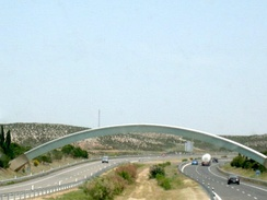 This arch that stretches over a highway indicates the prime meridian in Spain.