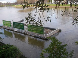 A litter trap catches floating waste in the Yarra River, east-central Victoria, Australia