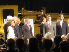 Candidates and moderators gather on the stage of the Republican Presidential Forum On Manufacturing