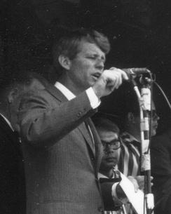 Tired but still intense in the last days before his Oregon defeat, Robert Kennedy speaks from the platform of a campaign train.
