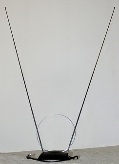 """Rabbit-ears"" VHF television antenna (the small loop is a separate UHF antenna)."