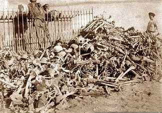 Human remains of Bolivian, Chilean and Peruvian soldiers exhumed from makeshift graves after the Battle of Tacna before their definitive interment in the Mausoleum of the Tacna cemetery in 1910.[189]