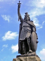 King Alfred the Great statue in Winchester, Hampshire. The 9th-century English king encouraged education in his kingdom, and proposed that primary education be taught in English, with those wishing to advance to holy orders to continue their studies in Latin.