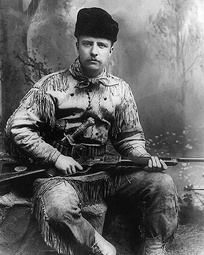 Theodore Roosevelt as Badlands hunter in 1885. New York studio photo.