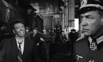 L. to R.: Paul Scofield, Michel Simon (background) and Burt Lancaster in The Train