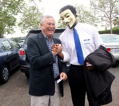 Rohrabacher shakes hands with a supporter wearing a Guy Fawkes mask in 2013