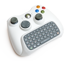 Xbox 360 Chatpad from the Messenger Kit attached to a wireless controller