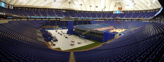 Metrodome set up for the 2009 NCAA Men's Basketball Tournament; temporary stands enclose the basketball court on two sides with the permanent stands on the other two.