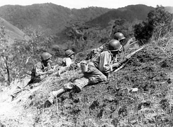 US troops approaching Japanese positions near Baguio, Luzon, 23 March 1945